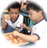 Kids playing xiangqi
